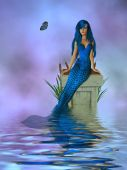stock photo of nymphet  - Mermaid sitting on a pedestal with cattails and butterfly - JPG
