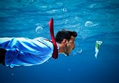 stock photo of fish  - Underwater scene of a businessman taking the bait - JPG