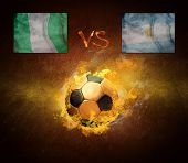 Hot soccer ball in fires flame, game Nigeria and Argentina