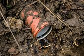 picture of wastewater  - Wastewater drain pipe pollution in muddy nature - JPG