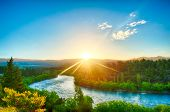 stock photo of bend over  - Beautiful sunset over the bend of the river Clutha - JPG
