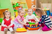 stock photo of girl toy  - Little girls playing with toys in the playroom - JPG