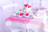 Beautiful spring table setting on light background