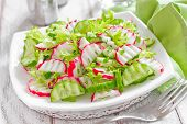 foto of radish  - Radish salad with cucumbers and fresh lettuce - JPG