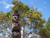 stock photo of indian totem pole  - Old tribal totem in the middle of the world - JPG