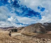 Bulldozer on road in Himalayas. Ladakh, Jammu and Kashmir, India