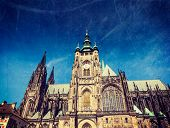 Vintage retro hipster style travel image of Gothic architecture facade of St. Vitus Catherdal, Pragu