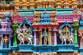 Shiva and Parvati on bull images. Sculptures on Hindu temple gopura (tower). Menakshi Temple, Madura