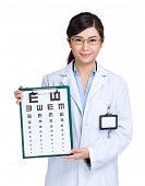 foto of snellen chart  - Optician woman showing eye exam chart - JPG