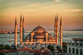 stock photo of muslim  - Blue mosque in glorius sunset - JPG