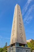 stock photo of obelisk  - The Obelisk of Theodosius at Sultanahmet park and the moon in the blue sky - JPG