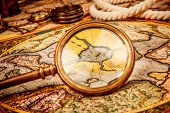 ������, ������: Vintage magnifying glass lies on the ancient map of the North Pole also Hyperborea Arctic contine