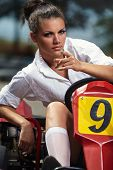 foto of karts  - Girl point you in Karting - JPG