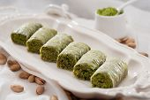 picture of baklava  - Close up of a plate of baklava with pistachios on the table - JPG
