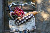 foto of wooden door  - Bicycle with picnic snack in wooden box on old wooden door background - JPG