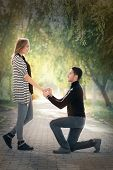 picture of marriage proposal  - Man proposing marriage with a romantic gesture - JPG