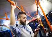 picture of tram  - Handsome hipster modern man calling by mobile phone in tram in night - JPG