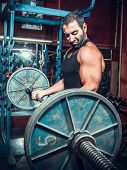 pic of muscle builder  - bodybuilder in training room  - JPG