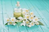 picture of jasmine  - Essential aroma oil with jasmine on wooden background - JPG