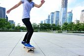picture of skateboarding  - young asian woman skateboarder skateboarding at city - JPG