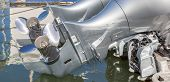 stock photo of outboard engine  - Double boat propellers behind the boat close - JPG