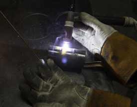 picture of tig  - Tig welding a test sample of pipe  - JPG