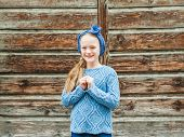 stock photo of headband  - Outdoor portrait of a cute fashion little girl - JPG
