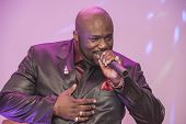 image of soul  - African male singer giving a live soul singing performance