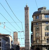 pic of tram  - two towers in Bologna Downtown in Italy with tram wires - JPG