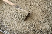 stock photo of concrete pouring  - Close up background and texture of mixed fresh concrete on construction site - JPG