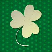 image of clover  - White paper three leaf clover on green background with clover pattern and old paper texture - JPG