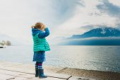 foto of jeans skirt  - Adorable toddler girl playing by the lake - JPG