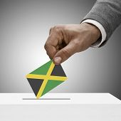 picture of jamaican flag  - Black male holding flag - JPG