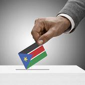 foto of sudan  - Black male holding flag - JPG