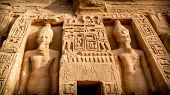 stock photo of pharaoh  - Statues of Ramses II guarding the entrance the temple of his wife Nefertari at Abu - JPG