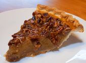 foto of pecan  - Pecan pie that has just been sliced and put on a plate - JPG
