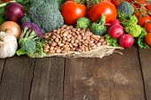 stock photo of pinto bean  - Pinto beans and vegatables on the old wooden table - JPG