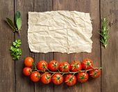 image of paper craft  - Cherry tomatoes herbs and craft paper on wooden background - JPG