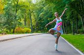 stock photo of ballerina  - Beautiful young ballerina dancing - JPG