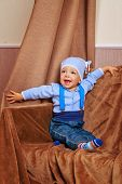 foto of suspenders  - Little cute baby in jacket and jeans with suspenders shot in home interior - JPG