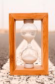 picture of time-bomb  - Time Concept Alarm Hourglass on the Asphalt Street - JPG