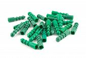 foto of butt plug  - Green plastic dowel pin pile isolated over white background - JPG