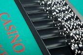 stock photo of gambler  - Black and white chips awaiting casino gamblers - JPG