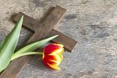 foto of crucifix  - Spring tulip and cross on vintage wooden board - JPG