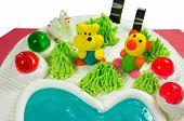 stock photo of fancy cake  - Fancy cake with sugar cartoon and jelly closeup - JPG