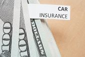 pic of insurance-policy  - Paper with words car insurance and money - JPG