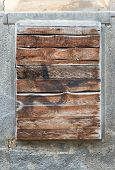 pic of character traits  - A old exterior brick wall with an old boarded up window ready for your content - JPG