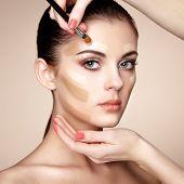 foto of foundation  - Makeup artist applies skintone - JPG