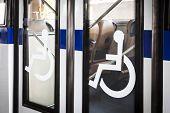 pic of handicapped  - Handicap sign on bus door entrance - JPG