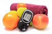 foto of diabetes  - Glucose meter fresh fruits dumbbells and purple towel for using in fitness concept for diabetes lifestyle and healthy nutrition - JPG